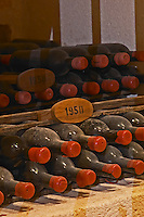 Bottles aging in the cellar. 1950. Chateau Grand Corbin Despagne, Saint Emilion Bordeaux France