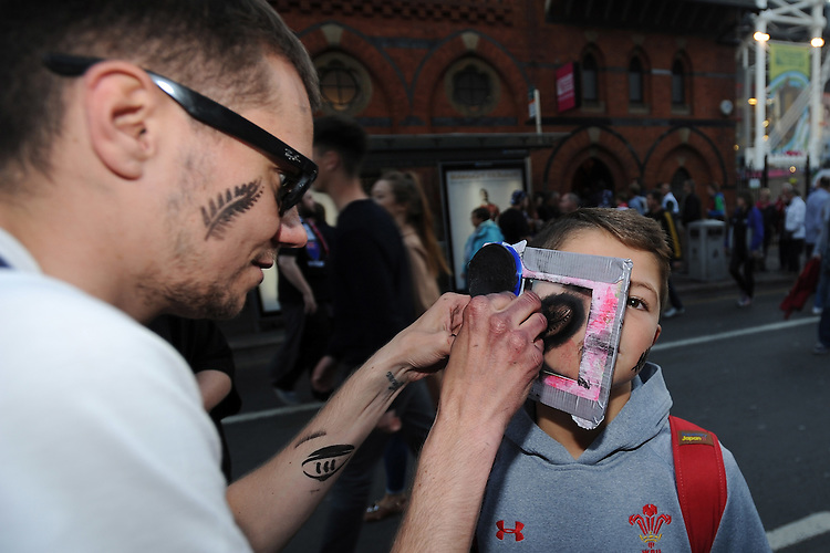 A young fan has his face painted ahead of Match 23 of the Rugby World Cup 2015 between New Zealand and Georgia - 02/10/2015 - Millennium Stadium, Cardiff<br /> Mandatory Credit: Rob Munro/Stewart Communications