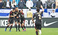 CARSON, CA - March 25, 2012: Hector Herrera (6), Alan Pulido (19) and Javier Aquino (11) of Mexico celebrate a goal during the Mexico vs Honduras match at the Home Depot Center in Carson, California. Final score Mexico 3, Honduras 0.