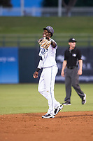 AFL West shortstop Lucius Fox (5), of the Peoria Javelinas and the Tampa Bay Rays organization, laughs with a teammate during the Fall Stars game at Surprise Stadium on November 3, 2018 in Surprise, Arizona. The AFL West defeated the AFL East 7-6 . (Zachary Lucy/Four Seam Images)