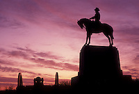 AJ4059, Gettysburg, civil war, battlefield, Gettysburg National Military Park, Pennsylvania, Silhouette of soldier and cavalier monument at East Cemetery Hill in Gettysburg Nat'l Military Park at sunset in Gettysburg in the state of Pennsylvania.