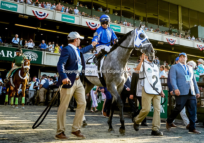 June 5, 2021: Bryson Cox, son of trainer Brad Cox, gets a fist bump from jockey Luis Saez, aboard eventual winner Essential Quality, before the running of the Belmont Stakes on Belmont Stakes Day at Belmont Park in Elmont, New York. Scott Serio/Eclipse Sportswire/CSM
