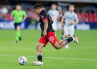 WASHINGTON, DC - MAY 13: Edison Flores #10 of D.C. United takes a shot during a game between Chicago Fire FC and D.C. United at Audi FIeld on May 13, 2021 in Washington, DC.