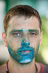 Olivier James Lavoie (Canada) displays the remainder of his face paint from a youth led Climate Carnival at the United Nations Climate Change Conference. (©Robert vanWaarden, Nusa Dua, Indonesia, Dec 6, 2007)