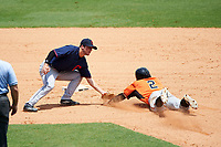 Cory Wood (2) of Sanderson High School in Raleigh, North Carolina playing for the Cleveland Indians scout team tags Akil Baddoo (2) sliding into second base during the East Coast Pro Showcase on July 30, 2015 at George M. Steinbrenner Field in Tampa, Florida.  (Mike Janes/Four Seam Images)