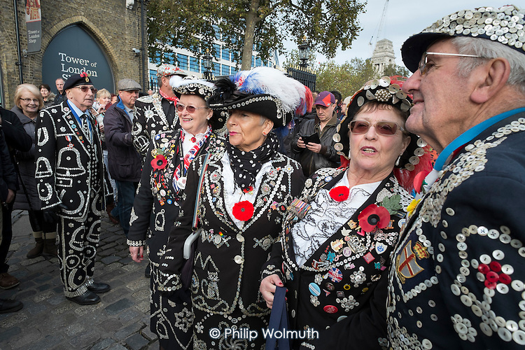 Pearly Queens and Kings from different London boroughs. Crowds mark Armistice Day at the Tower of London 100 years after the start of the First World War.