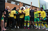 1st May 2021; Carrow Road, Norwich, Norfolk, England, English Football League Championship Football, Norwich versus Reading; Alexander Tettey of Norwich City celebrates with fans after winning the EFL championship
