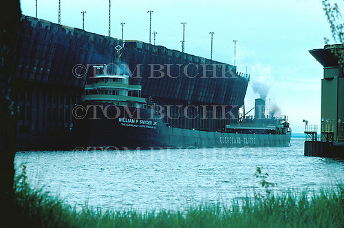 M/V William P Snyder Jr, part of the Cleveland-Cliffs Iron Company fleet, approaches the LS&I ore dock in Marquette Michigan's upper harbor on Lake Superior. Circa 1970's