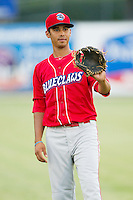 Gustavo Gonzalez (7) of the Lakewood BlueClaws warms up in the outfield prior to the game against the Kannapolis Intimidators at CMC-Northeast Stadium on August 13, 2013 in Kannapolis, North Carolina.  The Intimidators defeated the BlueClaws 12-8.  (Brian Westerholt/Four Seam Images)