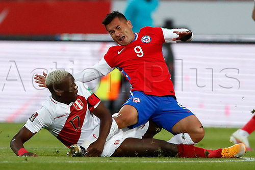 13th November 2020; National Stadium of Santiago, Santiago, Chile; World Cup 2020 Football qualification, Chile versus Peru;  Jean Meneses of Chile is brought down and fouled by Luis Advincula of Peru