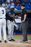 Wilmington Blue Rocks manager Gary Thurman (17) shakes hands with umpire Sean Cassidy prior to the game against the Hudson Valley Renegades at Dutchess Stadium on July 27, 2021 in Wappingers Falls, New York. (Brian Westerholt/Four Seam Images)
