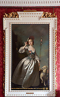 An 18th century portrait of a girl dressed as a shephardess which hangs in the dining room