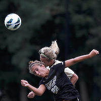 University of Central Florida midfielder Madison Barney (22) and Boston College midfielder Kate McCarthy (21) battle for head ball. After two overtime periods, Boston College tied University of Central Florida, 2-2, at Newton Campus Field, September 9, 2012.