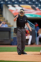 Umpire Richard Riley calls a strike during an International League game between the Durham Bulls and Toledo Mud Hens on July 16, 2019 at Fifth Third Field in Toledo, Ohio.  Durham defeated Toledo 7-1.  (Mike Janes/Four Seam Images)