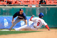 Pawtucket Red Sox third baseman Drew Sutton #44 tags out Anthony Gose #8 sliding into third during the first game of a doubleheader against the Buffalo Bisons on April 25, 2013 at Coca-Cola Field in Buffalo, New York.  Pawtucket defeated Buffalo 8-3.  (Mike Janes/Four Seam Images)