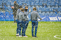 Luton Town players survey the pitch as snow falls ahead of  the FA Cup 4th round behind closed doors match between Chelsea and Luton Town at Stamford Bridge, London, England on 24 January 2021. Photo by David Horn.