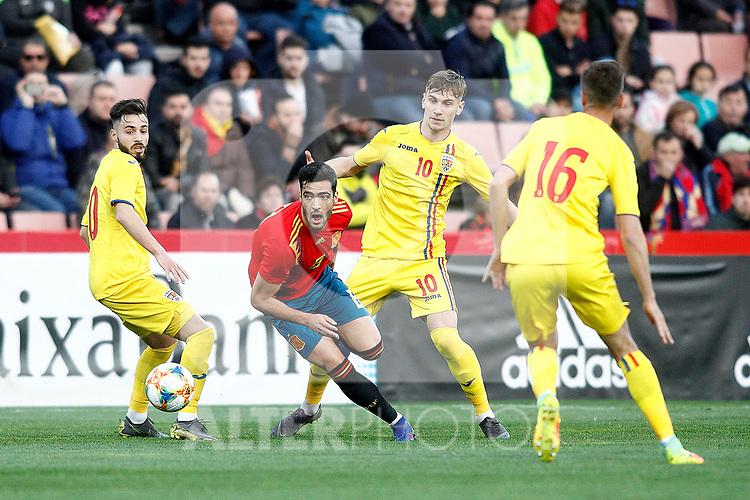 Spain's Mikel Merino  and Romania's Dragu? Denis, Romania's Nedelcu Dracos  during the International Friendly match on 21th March, 2019 in Granada, Spain. (ALTERPHOTOS/Alconada)