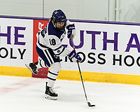 WORCESTER, MA - JANUARY 16: Sofia Smithson #19 of Holy Cross passes the puck during a game between Boston College and Holy Cross at Hart Center Rink on January 16, 2021 in Worcester, Massachusetts.