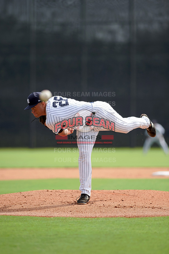 GCL Yankees East starting pitcher Tony Hernandez (26) follows through on a pitch during the first game of a doubleheader against the GCL Yankees West on July 19, 2017 at the Yankees Minor League Complex in Tampa, Florida.  GCL Yankees West defeated the GCL Yankees East 11-2.  (Mike Janes/Four Seam Images)