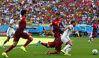 Joao Pereira of Portugal fouls Mario Goetze of Germany for a penalty, scored by Thomas Muller