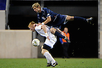 Kyle Soroka (5) of the Villanova Wildcats goes over the top of Tim Parker (18) of the St. John's Red Storm. St. John's defeated Villanova 2-0 during the second semifinal match of the Big East Men's Soccer Championships at Red Bull Arena in Harrison, NJ, on November 11, 2011.