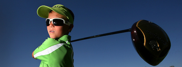 T.Lograsso.3.0709.jl.jpg  Kyle Lograsso, 10-year-old from Murrieta, lost an eye due to cancer when he was 2 and is now having a 100-hole charity golf tournament to raise awareness.  JAMIE SCOTT LYTLE | jlytle@nctimes.com