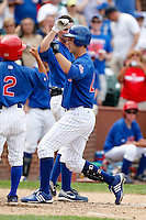 August 9, 2009:  Left Fielder John-Ford Griffin of the Iowa Cubs hits a home run to right field during a game at Wrigley Field in Chicago, IL.  Iowa is the Pacific Coast League Triple-A affiliate of the Chicago Cubs.  Photo By Mike Janes/Four Seam Images