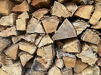 A neatly stacked pile of split and seasoned firewood helps warm a chilly winter.<br />(NWA Democrat-Gazette/Flip Putthoff)