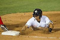 San Antonio Missions outfielder Rico Noel (17) dives back to first base in the Texas League baseball game against the Frisco Roughriders on August 22, 2013 at the Nelson Wolff Stadium in San Antonio, Texas. Frisco defeated San Antonio 2-1. (Andrew Woolley/Four Seam Images)
