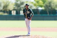 Oakland Athletics relief pitcher Leudeny Pineda (59) looks in for the sign during an Instructional League game against the Los Angeles Dodgers at Camelback Ranch on September 27, 2018 in Glendale, Arizona. (Zachary Lucy/Four Seam Images)