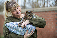 A long lost pet cat has been reunited with his owner - 14 years after going missing