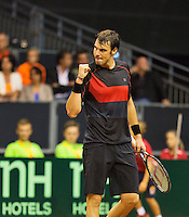 September 12, 2014, Netherlands, Amsterdam, Ziggo Dome, Davis Cup Netherlands-Croatia, Mate Delic (CRO) reacts<br /> Photo: Tennisimages/Henk Koster