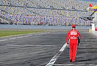 Feb 08, 2009; Daytona Beach, FL, USA; NASCAR Sprint Cup Series driver Tony Stewart walks towards the garage following qualifying for the Daytona 500 at Daytona International Speedway. Mandatory Credit: Mark J. Rebilas-