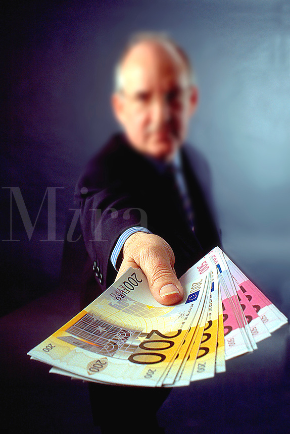 RELEASED...Man offering money in the form of Euro banknotes