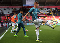 Sam Clucas of Swansea City warms up during the Premier League match between Swansea City and Watford at The Liberty Stadium, Swansea, Wales, UK. Saturday 23 September 2017