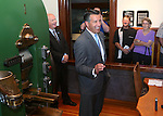 Nevada Museum and History Director Peter Barton, left rear, listens as Gov. Brian Sandoval speaks at a ceremony marking the beginning of production of the fourth and final medallion in a commemorative Sesquicentennial series at the Nevada State Museum, in Carson City, Nev., on Wednesday, Sept. 3, 2014. <br /> Photo by Cathleen Allison