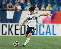 FOXBOROUGH, MA - JULY 18: Hwang In-Beom #4 passes the ball during a game between Vancouver Whitecaps and New England Revolution at Gillette Stadium on July 18, 2019 in Foxborough, Massachusetts.