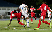 GEORGETOWN, GRAND CAYMAN, CAYMAN ISLANDS - NOVEMBER 19: Weston McKennie #8 of the United States moves with the ball as Cuba's Dario Ramos #16 battles during a game between Cuba and USMNT at Truman Bodden Sports Complex on November 19, 2019 in Georgetown, Grand Cayman.