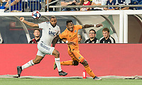 FOXBOROUGH, MA - JUNE 29: Andrew Farrell #2, Romell Quioto #31 battle for the ball during a game between Houston Dynamo and New England Revolution at Gillette Stadium on June 29, 2019 in Foxborough, Massachusetts.