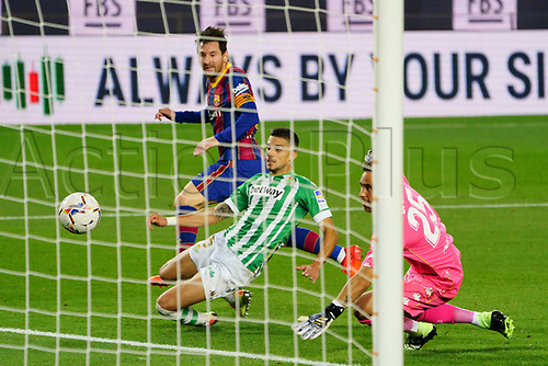 7th November 2020; Camp Nou, Barcelona, Catalonia, Spain; La Liga Football, Barcelona versus Real Betis;  Leo Messi beats the defender Bartra before scoring past keeper Bravo