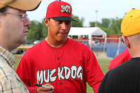 Batavia Muckdogs pitcher Javier Avendano #27 signs autographs during the teams pre-season pep rally at Dwyer Stadium on June 15, 2011 in Batavia, New York.  Photo By Mike Janes/Four Seam Images