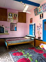 The largest bedroom is furnished with three beds, two doubles and a single.  It is also the room with the television, where the family gathers to watch favourite programmes