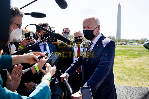 US President Joe Biden delivers brief remarks on infrastructure to members of the news media after arriving on the Ellipse by Marine One en route to the White House, in Washington, DC, USA, 05 April 2021. Biden returns to the White House following a trip to Camp David.<br /> CAP/MPI/RS<br /> ©RS/MPI/Capital Pictures