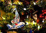 Christmas ornament of a mouse flying an airplane