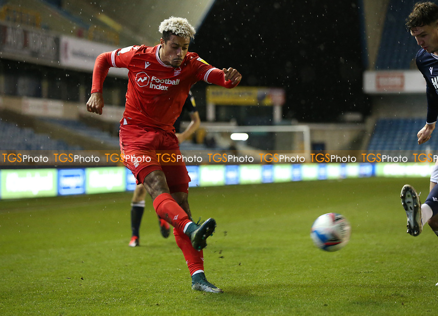 Lyle Taylor of Nottingham Forest crosses the ball during Millwall vs Nottingham Forest, Sky Bet EFL Championship Football at The Den on 19th December 2020