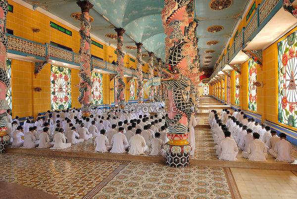 Asia, Vietnam, Tay Ninh nr. Ho Chi Minh City (Saigon). Cao Dai Holy See in Tay Ninh. Cao Dai ceremony in the prayer hall of the Great Divine Temple (built 1933-1955).