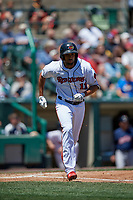 Rochester Red Wings second baseman Leonardo Reginatto (11) runs to first base during a game against the Scranton/Wilkes-Barre RailRiders on June 7, 2017 at Frontier Field in Rochester, New York.  Scranton defeated Rochester 5-1.  (Mike Janes/Four Seam Images)