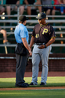 Bristol Pirates manager Miguel Perez (41) talks with home plate umpire Kyle Stutz during a game against the Elizabethton Twins on July 28, 2018 at Joe O'Brien Field in Elizabethton, Tennessee.  Elizabethton defeated Bristol 5-0.  (Mike Janes/Four Seam Images)
