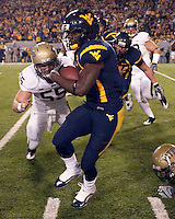 Pitt linebacker Max Gruder (55) closes in on WVU running back Noel Devine (7). The West Virginia Mountaineers defeated the Pittsburgh  Panthers 19-16 on November27, 2009 at Mountaineer Field at Milan Puskar Stadium, Morgantown, West Virginia.