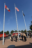 Bentonville High School ROTC students lower the American Flag on Tuesday Sept. 7 2021 to fly a Freedom Flag beneath it at the school's 9-11 remembrance ceremony. Go to nwaonline.com/210911Daily/ to see more photos.<br />(NWA Democrat-Gazette/Flip Putthoff)